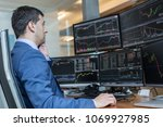 male stock broker trading... | Shutterstock . vector #1069927985