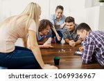 a group of friends play board... | Shutterstock . vector #1069936967
