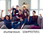 friends playing video games in... | Shutterstock . vector #1069937051