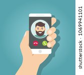 incoming call on smartphone... | Shutterstock .eps vector #1069941101