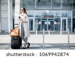 business woman standing near... | Shutterstock . vector #1069942874