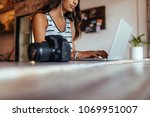 woman blogger using laptop at... | Shutterstock . vector #1069951007