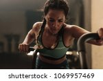 woman doing intense workout on... | Shutterstock . vector #1069957469