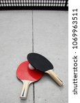 Small photo of Table Tennis racket with ball on a Table Tennis Table