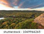 the big carp river cuts a swath ... | Shutterstock . vector #1069966265
