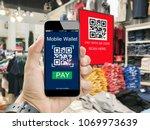 moblie wallet payment with qr... | Shutterstock . vector #1069973639