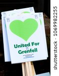 London, United Kingdom, 14th April 2018:- Banners ready for a silent march from Kensington Town Hall to the ruins of Grenfell tower ten months on from the devastating fire that killed 71 - stock photo