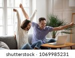 excited man and woman screaming ... | Shutterstock . vector #1069985231
