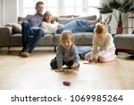 cute kids playing while parents ... | Shutterstock . vector #1069985264