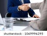 business people shaking hands ... | Shutterstock . vector #1069996295