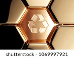 golden recycle icon in the...