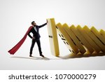 the man stops the falling... | Shutterstock . vector #1070000279