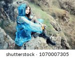 a lonely beautiful girl in a... | Shutterstock . vector #1070007305