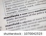 Small photo of Close up to the dictionary definition of Manifesto