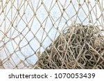empty fishnets on light blue...