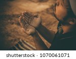silhouette young asian muslim... | Shutterstock . vector #1070061071
