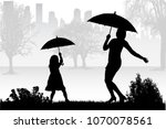 silhouettes under the umbrella. | Shutterstock .eps vector #1070078561