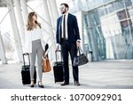 business couple walking with... | Shutterstock . vector #1070092901