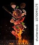 flying pieces of beef meat... | Shutterstock . vector #1070095175