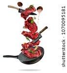 flying pieces of beef steaks... | Shutterstock . vector #1070095181