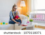 stay at home mom working on... | Shutterstock . vector #1070118371