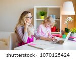 mom with two daughters working... | Shutterstock . vector #1070125424