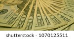 Small photo of multiple twenty dollar American bills
