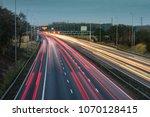 fast moving traffic drives... | Shutterstock . vector #1070128415