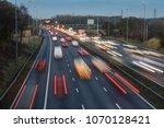 fast moving traffic drives... | Shutterstock . vector #1070128421