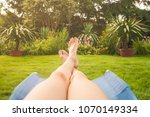 woman relaxing her feet in the... | Shutterstock . vector #1070149334