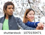 young couple springtime in... | Shutterstock . vector #1070150471