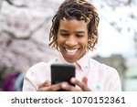 man texting on his cell phone... | Shutterstock . vector #1070152361