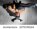 man lying on a bench holds a... | Shutterstock . vector #1070198264