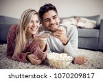 happy couple watching tv and... | Shutterstock . vector #1070209817