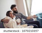 happy couple watching...   Shutterstock . vector #1070210357