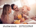 family making juice in their... | Shutterstock . vector #1070210969