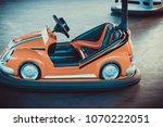 colorful electric bumper car in ... | Shutterstock . vector #1070222051