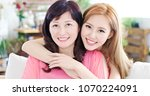 daughter with her mother smile... | Shutterstock . vector #1070224091
