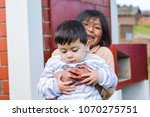 two latin siblings hugging... | Shutterstock . vector #1070275751
