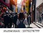 young asian woman traveler... | Shutterstock . vector #1070278799