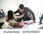 businessman sexually harassing... | Shutterstock . vector #1070290025