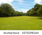 green grass green trees in... | Shutterstock . vector #1070298164
