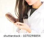woman looking at her hair for... | Shutterstock . vector #1070298854