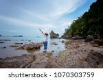 happy woman stand on rock at... | Shutterstock . vector #1070303759