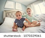 young laughing and playful... | Shutterstock . vector #1070329061