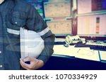 double exposure of engineer or... | Shutterstock . vector #1070334929