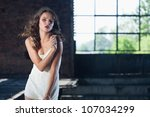 young gorgeous brunette posing... | Shutterstock . vector #107034299