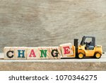 toy yellow forklift hold block...   Shutterstock . vector #1070346275