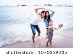 portrait of happy family ... | Shutterstock . vector #1070359235