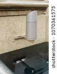 Small photo of all-weather luminaire for architectural lighting installed on a marble wall